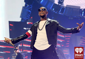 Usher onstage at the iHeartRadio Music Festival