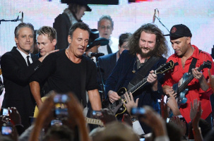 Jon Stewart, honoree Bruce Springsteen, singer Jim James and guitarist Tom Morello